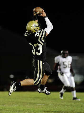 Nederland tight end Korbin Stampley, 33, makes a great catch for another Bulldog first down during the Nederland High School football game against Central High School in Nederland on Friday, November 9, 2012.Photo taken:Randy Edwards/The Enterprise Photo: Randy Edwards