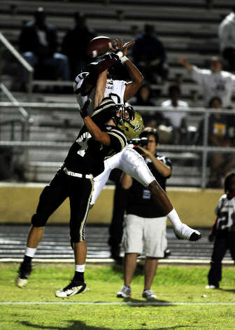 Nederland defensive player Seth Barrow, 4, is flagged for pass interference during the Nederland High School football game against Central High School in Nederland on Friday, November 9, 2012.Photo taken:Randy Edwards/The Enterprise Photo: Randy Edwards