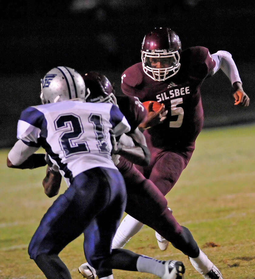 Tiger #5, Patrick Reed, right, looks to go around Mustang defender #21, Colin Janice, left, who himself was busy trying to get around one of Reed's teammates.   The Silsbee High School Tigers hosted the West Orange-Stark High School Mustangs Friday night November 9, 2012 at Tiger stadium in Silsbee. This is a District 21-3A game, and both teams were undefeated in district play going into the game.At the half, the Mustangs are up 13-12.	 Dave Ryan/The Enterprise Photo: Dave Ryan, Dave Ryan/The Enterprise