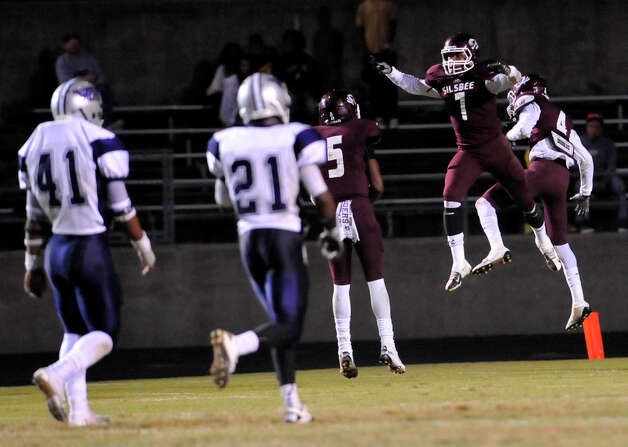 Tigers #7, Jordan Holmes, left, and #4, Coy Bird, celebrate in the endzone after scoring a touchdown for the Tigers.  The Silsbee High School Tigers hosted the West Orange-Stark High School Mustangs Friday night November 9, 2012 at Tiger stadium in Silsbee. This is a District 21-3A game, and both teams were undefeated in district play going into the game.At the half, the Mustangs are up 13-12.	 Dave Ryan/The Enterprise Photo: Dave Ryan, Dave Ryan/The Enterprise