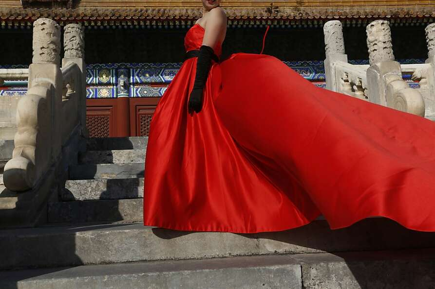 A Chinese bride poses for a picture at Imperial Ancestral Temple in Beijing, China, Monday, Nov. 12,