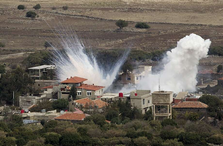 Israel gets involved: A shell fired by Syrian artillery explodes in the Syrian village of Bariqa. Israel said that one of its tanks fired on and struck a Syrian army vehicle Monday after a mortar shell landed, apparently accidentally, on Israeli-held territory. It was the first direct confrontation between the countries since the Syrian uprising broke out. Photo: Ariel Schalit, Associated Press