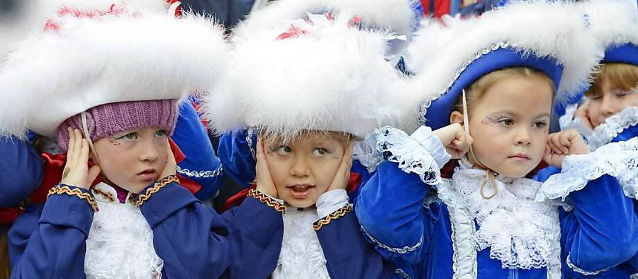 Everyone's a music critic:Actually these Funkenmariechen (young majorette dancers) were reacting not to the band's selection, but to cannon fire sounding the start of carnival season in Erfurt, Germany. Photo: Jens Meyer, Associated Press