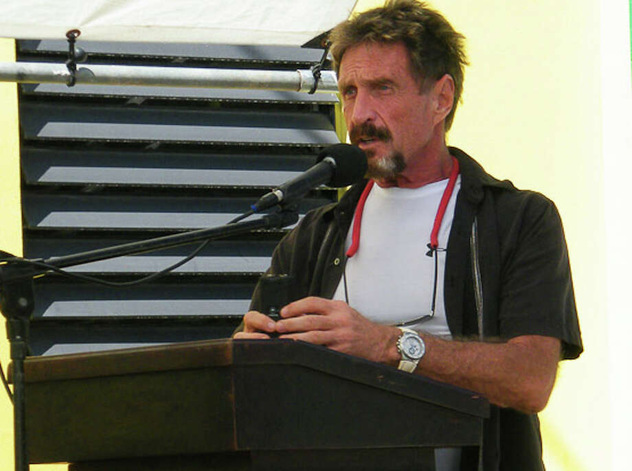 John McAfee speaks last week after donating equipment to the Belizean police. Photo: Courtesy Of 7 Belize News