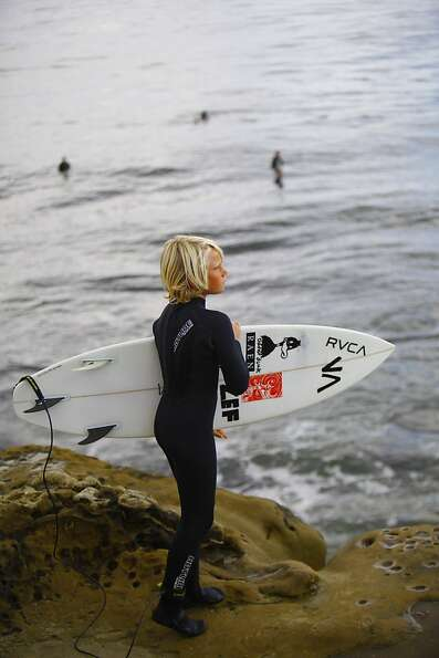 A young surfer scans the break off Santa Cruz. The Pleasure Point neighborhood is home to an assortm