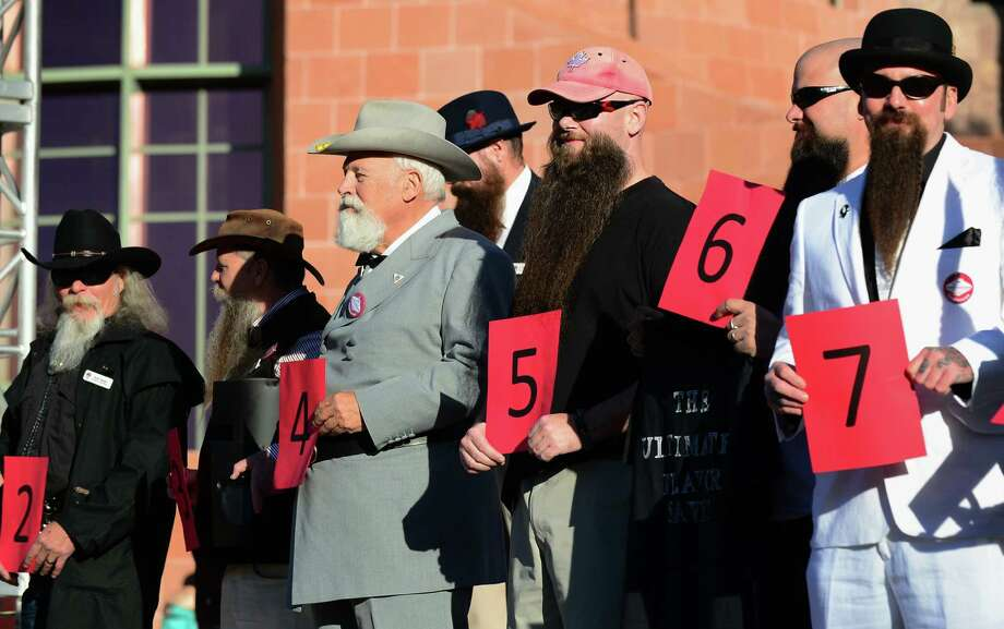 Contestants in the Natural Goatee category hold their number for judges and the crowd at the third annual National Beard and Moustache Championships in Las Vegas, Nevada on November 11, 2012. Photo: FREDERIC J. BROWN, AFP/Getty Images / AFP
