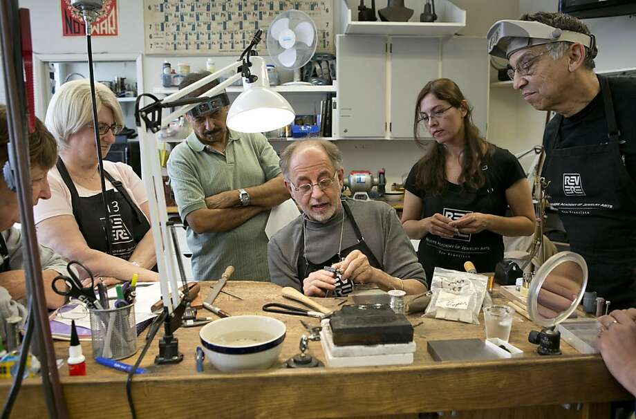 Master goldsmith Alan Revere demonstrates a tool to an advanced fabrication class. His students may put their skills to use as future master craftspeople, hobbyists or Etsy sellers. Photo: Laura Morton, Special To The Chronicle