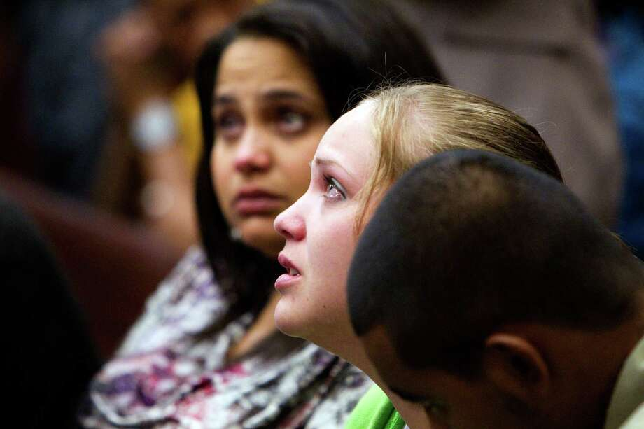 Keisha Brown, mother of 16-month-old day care fire victim, Elias Castillo, listens during closing arguments where home day care operator Jessica Tata is on trial for one count of felony murder at the Harris County Criminal Justice Center Monday, Nov. 12, 2012, in Houston. 