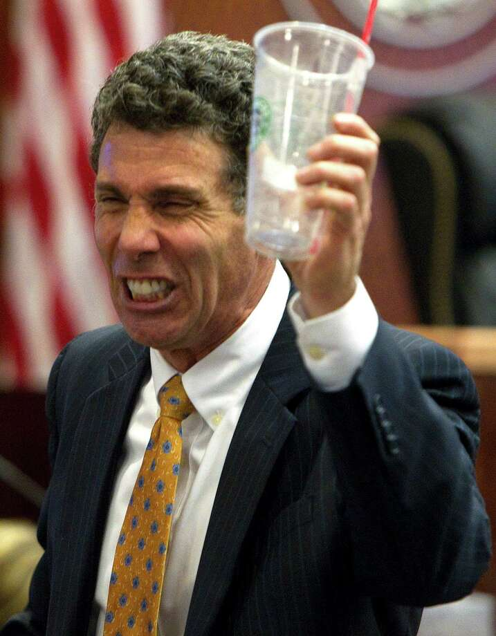 Prosecutor Steve Baldassano holds up a Starbucks cup during his closing arguments in the murder case against home day care operator Jessica Tata who is charged with murder for the death of 16-month-old day care fire victim, Elias Castillo, at the Harris County Criminal Justice Center Monday, Nov. 12, 2012, in Houston. 