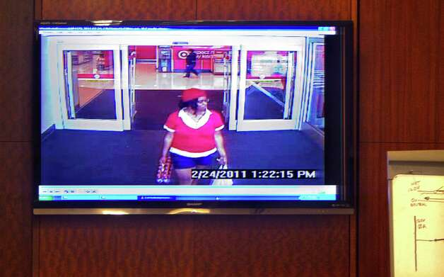 A video shows home day care operator Jessica Tata leaving a Target store as prosecutor Steve Baldassano gives his closing arguments in the murder case against Tata who is charged with murder for the death of 16-month-old day care fire victim, Elias Castillo, at the Harris County Criminal Justice Center Monday, Nov. 12, 2012, in Houston.  Baldassano said that Tata was at a Target more concerned getting a drink than the well-being of the children she was to be caring for. Tata was charged after leaving seven children, between the ages of 15 months and 3 years old unattended to go shopping when a fire started in the home that killed four children at a Houston woman's home day care Feb. 24, 2011. Tata faces up to life in prison if convicted on that charge, though jurors can find her guilty on several lesser counts. Photo: Johnny Hanson, Houston Chronicle / © 2012  Houston Chronicle