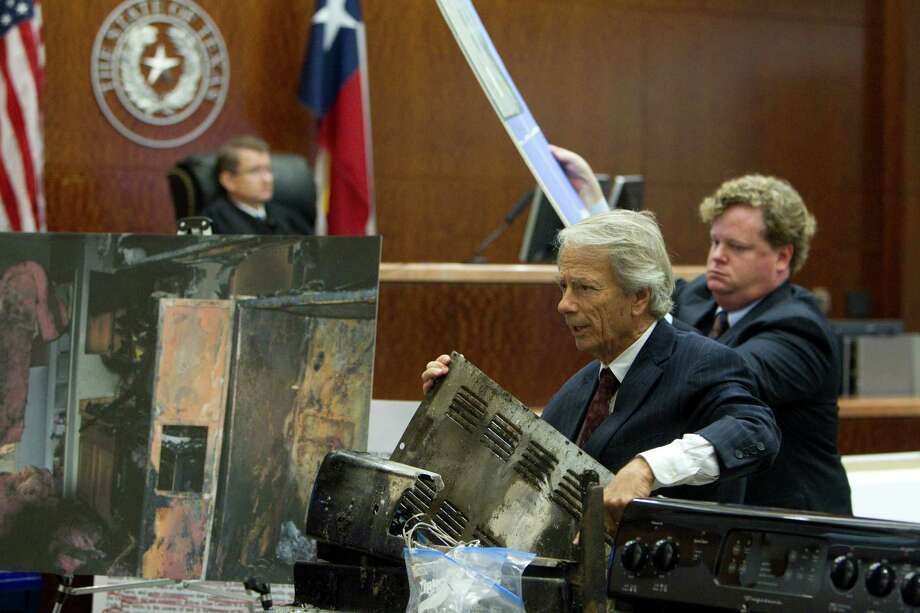 Showing a picture and using evidence from the stove in the burned kitchen, Mike DeGeurin, defense attorney for home day care operator Jessica Tata gives his closing arguments in her murder trial for the death of 16-month-old day care fire victim, Elias Castillo, at the Harris County Criminal Justice Center Monday, Nov. 12, 2012, in Houston. 