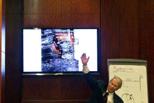 Showing a picture of the burned kitchen and stove, Mike DeGeurin, defense attorney for home day care operator Jessica Tata gives his closing arguments in her murder trial for the death of 16-month-old day care fire victim, Elias Castillo, at the Harris County Criminal Justice Center Monday, Nov. 12, 2012, in Houston. 