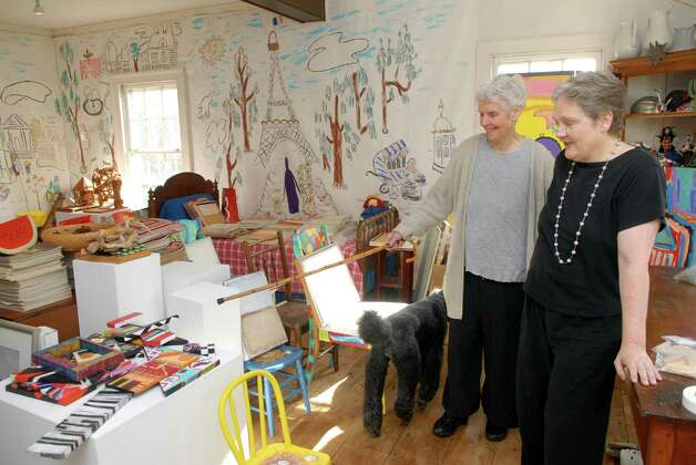 Patsy Murphey Whitman runs the PMW Gallery from her Roxbury Road home in Stamford, Conn. with the help of partner Betsy Adams on Monday November 12, 2012. A new exhibit along with some of their personal collection is stored in the holding room. Photo: Dru Nadler / Stamford Advocate Freelance