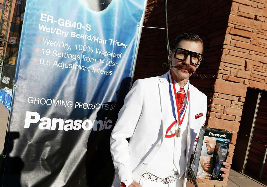 IMAGE DISTRIBUTED FOR PANASONIC - Daniel Lawlor poses after winning the moustache freestyle competition during the 2012 National Beard and Moustache Championship, on Sunday, Nov. 11, 2012 in Las Vegas. (Photo by Isaac Brekken/Invision for Panasonic/AP Images) Photo: Isaac Brekken, Associated Press / Invision