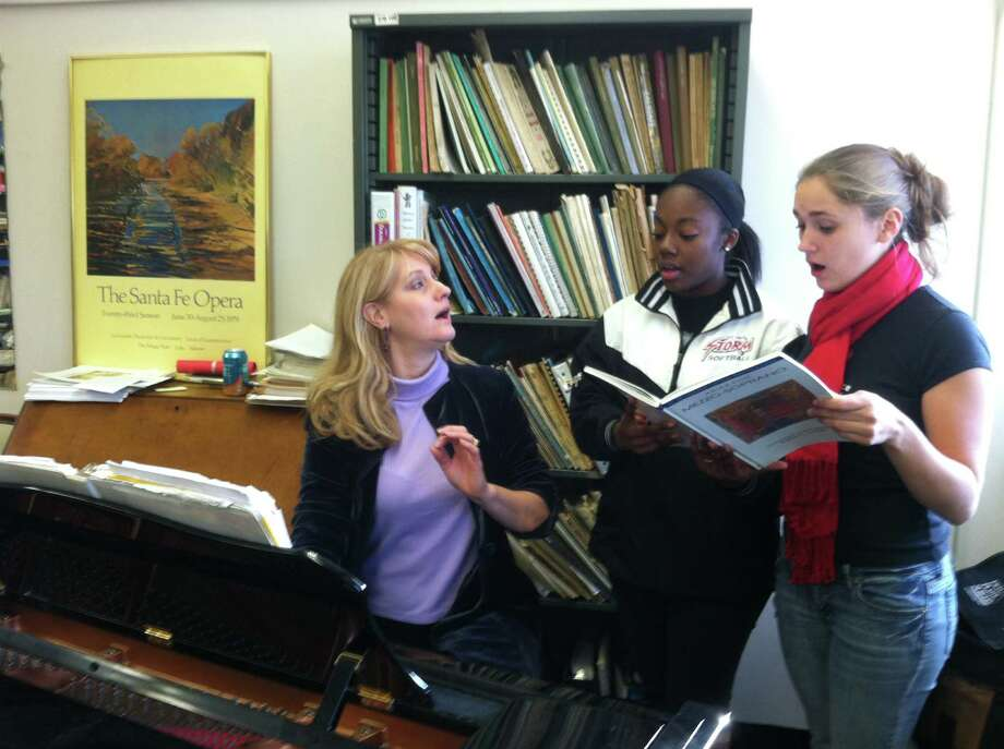 Kristin Huffman of the New Paradigm Theatre coaches two of her students, Bria Yarborough from Stamford, center, and Kelly Shemeth from Berlin, on the right. They will perform Dec. 16 at Lockwood-Mathews Mansion Museum. Photo: Contributed Photo