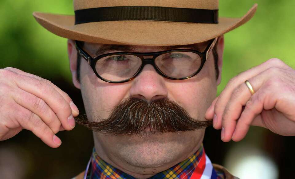 Adam Orcutt from Michigan City, Indiana, poses after winning first place in the Natural Moustache ca