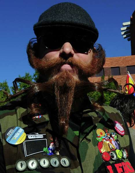 Austin Buchanan from Clearwater, Florida, arrives for the third annual National Beard and Moustache