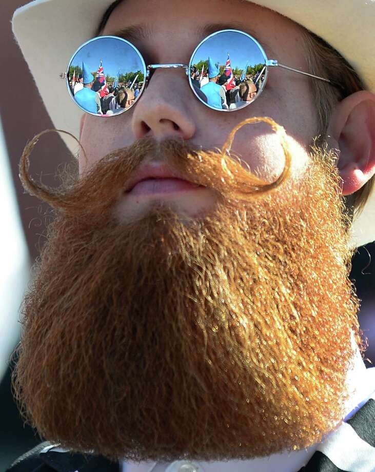 The crowd is reflected in the glasses of a bearded competitor at the third annual National Beard and Moustache Championships in Las Vegas, Nevada on November 11, 2012. AFP PHOTO / Frederic J. BROWNFREDERIC J. BROWN/AFP/Getty Images Photo: FREDERIC J. BROWN, AFP/Getty Images / AFP