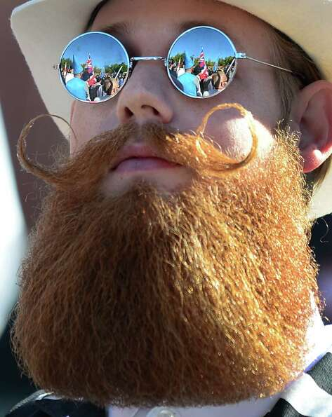 The crowd is reflected in the glasses of a bearded competitor at the third annual National Beard and