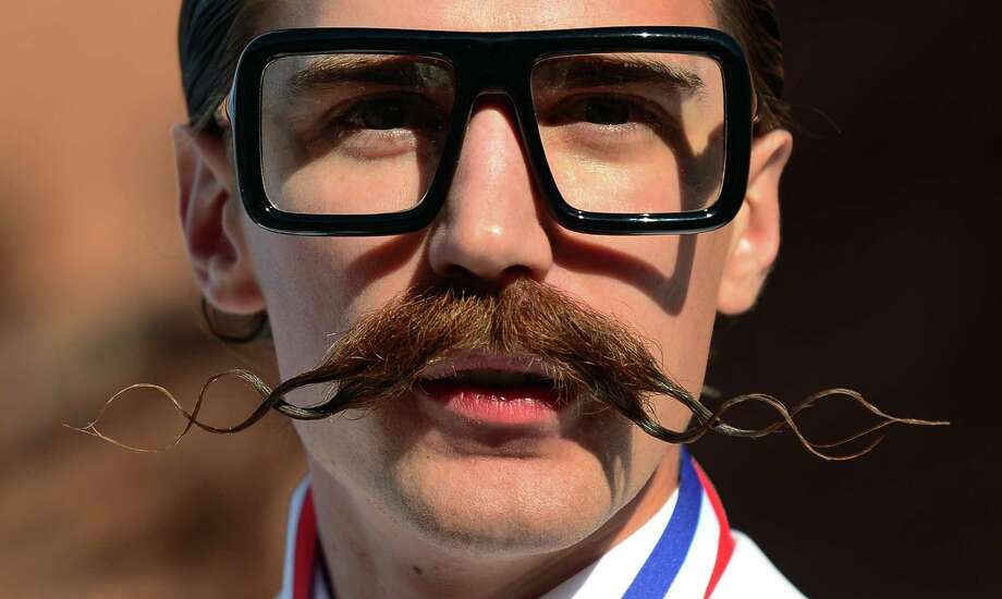 Daniel Lawlor from Los Angeles, California, poses after winning first place in the Freestyle Moustache category at the third annual National Beard and Moustache Championships in Las Vegas, Nevada on November 11, 2012. AFP PHOTO / Frederic J. BROWNFREDERIC J. BROWN/AFP/Getty Images Photo: FREDERIC J. BROWN, AFP/Getty Images / AFP