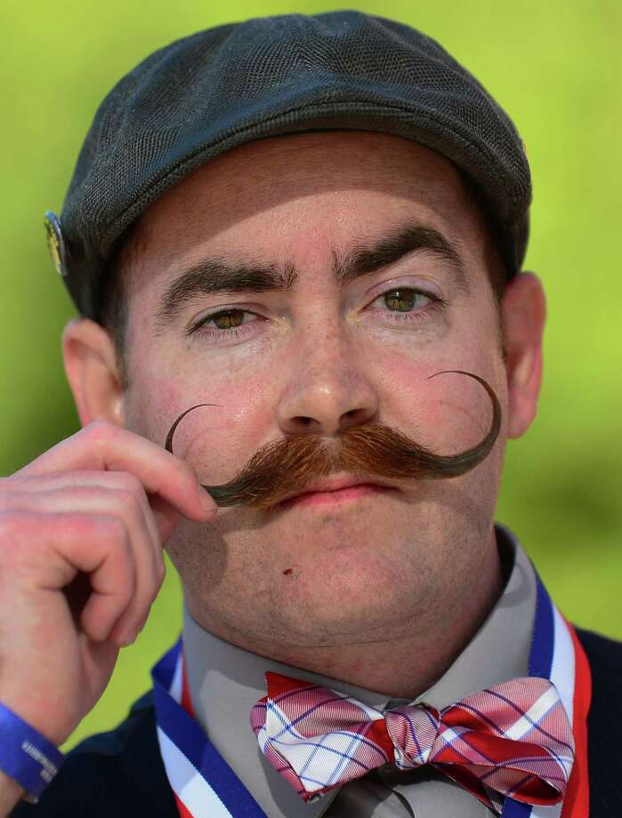 Steve McQuaide from Burbank, California, poses after winning first place in the Imperial Moustache category at the third annual National Beard and Moustache Championships in Las Vegas, Nevada on November 11, 2012. AFP PHOTO / Frederic J. BROWNFREDERIC J. BROWN/AFP/Getty Images Photo: FREDERIC J. BROWN, AFP/Getty Images / AFP