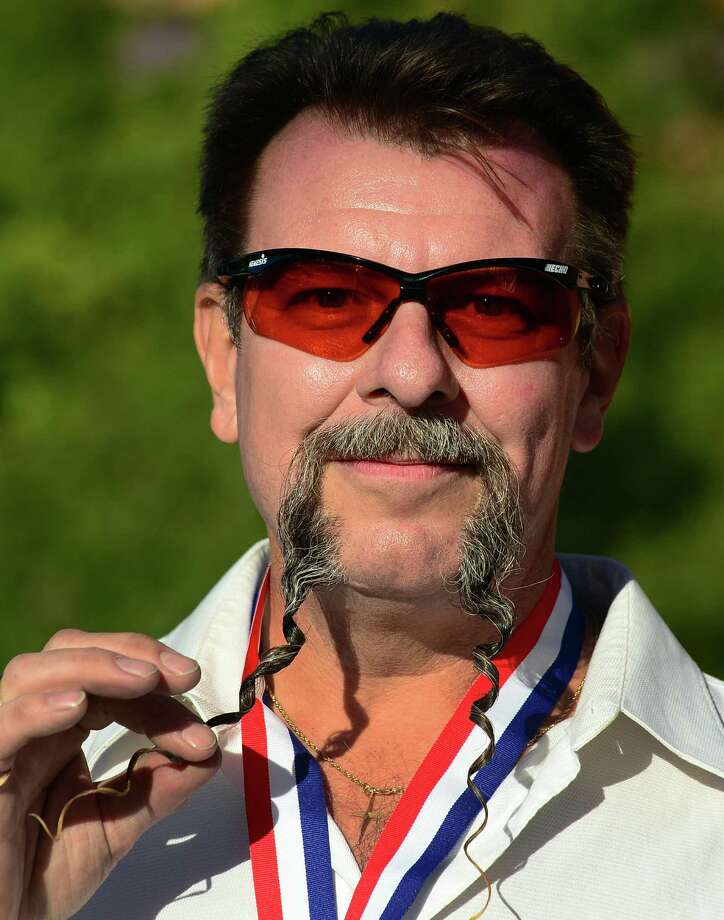 Wojo Wrzesniewski from Toronto, Canada, poses after winning first place in the Fu Manchu Moustache category at the third annual National Beard and Moustache Championships in Las Vegas, Nevada on November 11, 2012. AFP PHOTO / Frederic J. BROWNFREDERIC J. BROWN/AFP/Getty Images Photo: FREDERIC J. BROWN, AFP/Getty Images / AFP