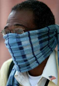 Anthony Kelly wears a scarf around his during a cold and breezy Monday morning, Nov. 12, 2012, in Houston. Kelly said he wore the scarf to keep his ears warm. Photo: Cody Duty, Houston Chronicle / © 2012 Houston Chronicle
