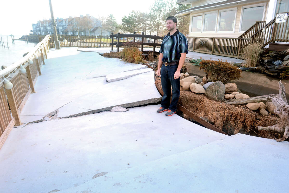 Peter Massey, manager at Knapp's Landing, stands on restaurant's damaged back deck overlooking the Housatonic River, in Stratford, Conn. Nov. 12th, 2012. The deck and a koi pond were damaged two weeks ago during storm Sandy.