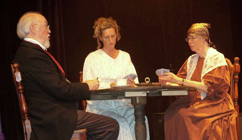 "The Town Players of New Canaanís fall show, Ivan Turgenevís comedy drama ""A Month in the Country"" begins with a card game played by John Pyron, Lorelei Young Atwood and Cynthia Sepe. Photo: Contributed"