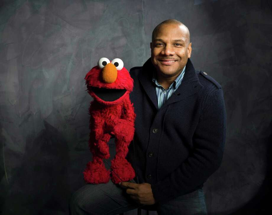 "FILE - This Jan. 24, 2011 photo shows ""Sesame Street"" muppet Elmo and puppeteer Kevin Clash poses for a portrait in the Fender Music Lodge during the 2011 Sundance Film Festival to promote the film ""Being Elmo"" in Park City, Utah. Clash has taken a leave of absence from the popular kids' show following allegations that he had a relationship with a 16-year-old boy. Sesame Workshop says Kevin Clash denies the charges, which were first made in June by the alleged partner, who by then was 23. In a statement issued Monday, Nov. 12, 2012, Sesame Workshop says its investigation found the allegation of underage conduct to be unsubstantiated.   (AP Photo/Victoria Will, file) Photo: Victoria Will"