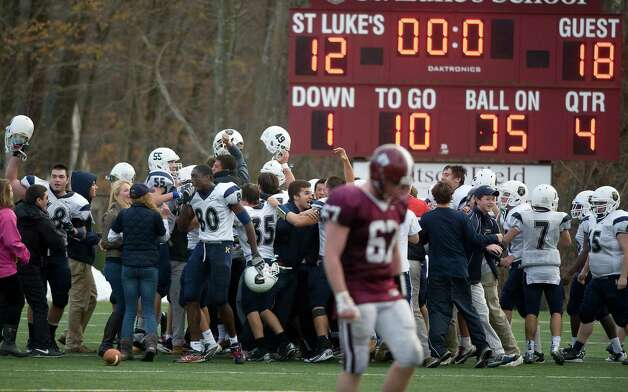 King football celebrates their win over St. Luke's in New Canaan on Saturday, November 10.  Contributed photo Photo: Contributed Photo / Stamford Advocate Contributed