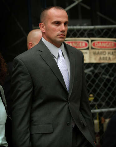 Former Milford police officer Jason Anderson exits Superior Court in Milford on Tuesday, October 23, 2012. Anderson is on trial for manslaughter for the June 13, 2009 deaths of Orange residents David Servin and Ashlie Krakowski. Photo: Brian A. Pounds / Connecticut Post