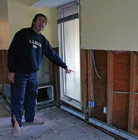 Tony Sousa points to the high-water mark of the flooding that breached the first floor of his Marine Avenue home during Hurricane Sandy. Monday, Nov. 12, 2012/ Westport, CT Photo: Paul Schott / Westport News