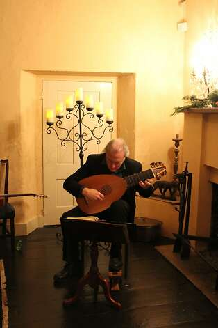 Lute player Robert McNamara performs in the Larkin House, built by a Yankee merchant in 1834 and one of 22 sites on the Christmas in the Adobes walking tour in Monterey. Photo: Cindy Ewing, California State Parks