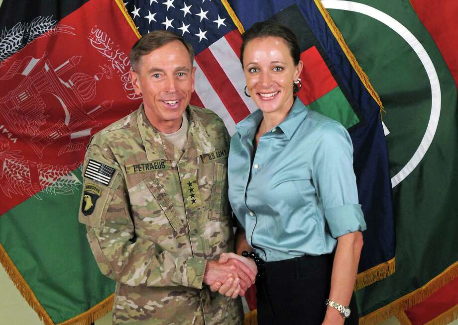 Gen. David Petraeus, then the NATO International Security Assistance Force commander, with Paula Broadwell, his biographer, in Afghanistan on July 13, 2011 in a handout photo. Lawmakers expressed concern Sunday over the lack of oversight into the inquiry that exposed an affair between Petraeus and Broadwell. (International Security Assistance Force NATO via The New York Times) Photo: INTERNATIONAL SECURITY ASSISTANC, New York Times / New York Times