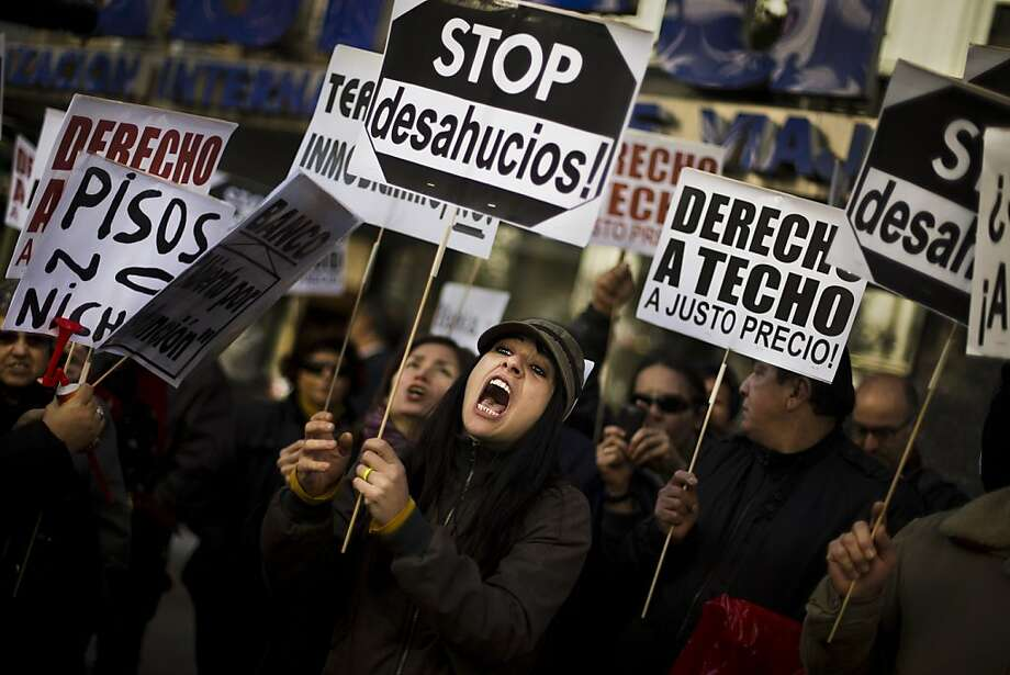 In Madrid, demonstrators coping with the second recession in three years demand a stop to evictions, which have affected more than 350,000 people. Photo: Daniel Ochoa De Olza, Associated Press