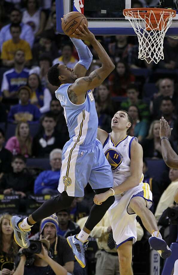 Klay Thompson was unable to keep Andre Iguodala from going to the rim in Denver's double-OT win. Photo: Ben Margot, Associated Press