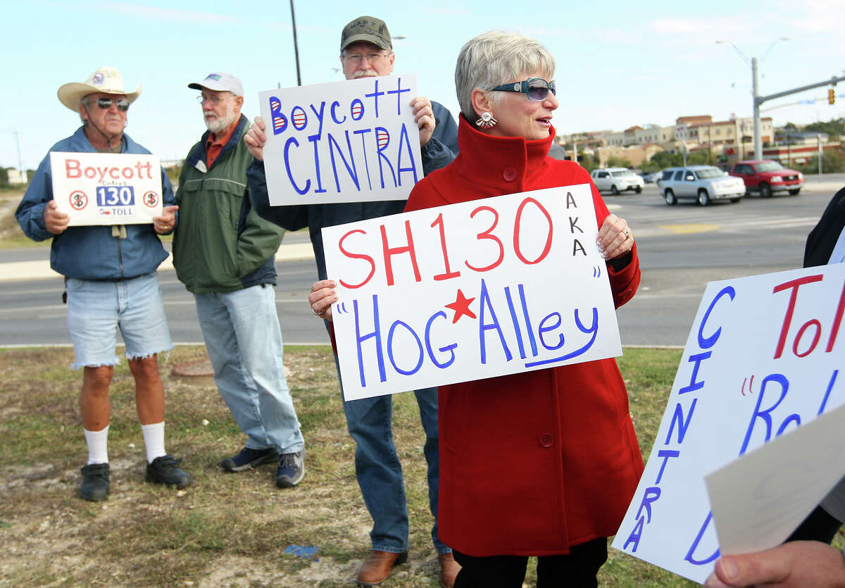 Members of Texans Uniting for Reform and Freedom and Texans for Accountable Government call for a boycott of Texas toll road State Highway 130 at a news conference at  Stone Oak Boulevard and U.S. 281, on Nov. 12, 2012. From left, Mike Wikman, Ron Schumacher, Richard Lindell and Sudie Sartor, hold protest signs.