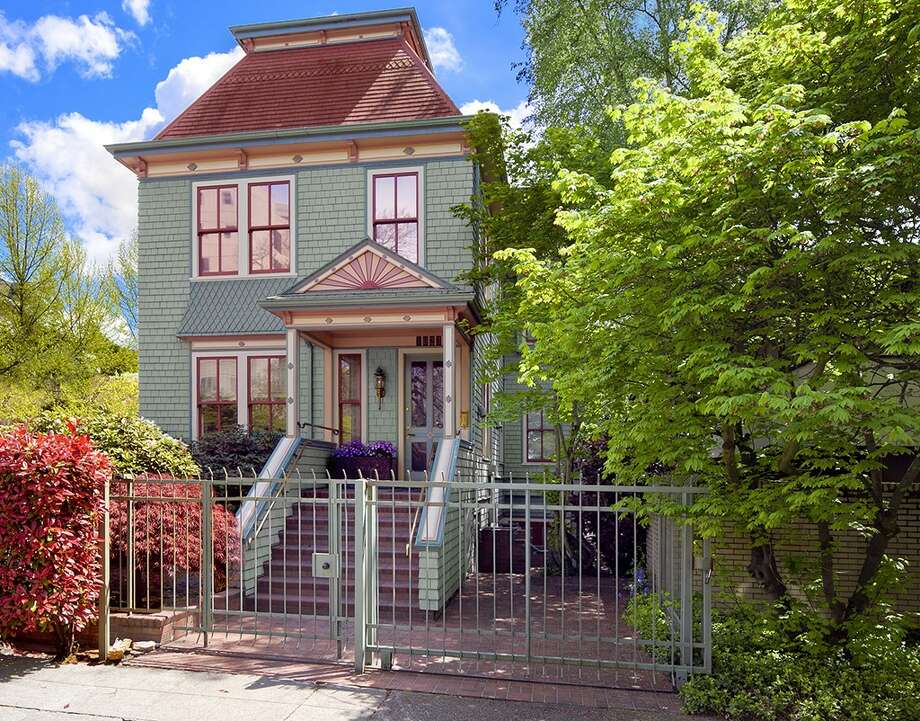 Front of 1023 Columbia St. The 3,800-square-foot Painted Lady, built in 1900, has four bedrooms, 2.5 bathrooms, a reception hall, offices, a library, three fireplaces, built-in shelves, wood paneling and a front porch on a 2,400-square-foot lot. It's listed for $2.68 million. Photo: Courtesy Wendy Lister/Coldwell Banker Bain