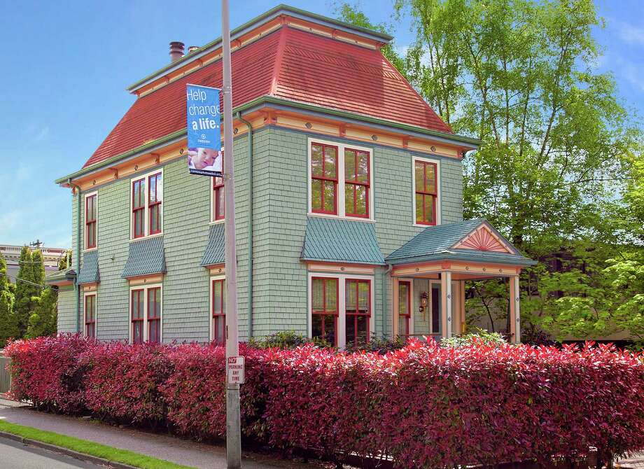 Here's a home that would fit in well among San Francisco's Victorian Painted Ladies but is quite distinctive for Seattle. The house, 1023 Columbia St., in First Hill, was built in 1900. It is 3,800 square feet, with four bedrooms, 2.5 bathrooms, a reception hall, offices, a library, three fireplaces, built-in shelves, wood paneling and a front porch on a 2,400-square-foot lot. It's listed for $2.68 million. Photo: Courtesy Wendy Lister/Coldwell Banker Bain