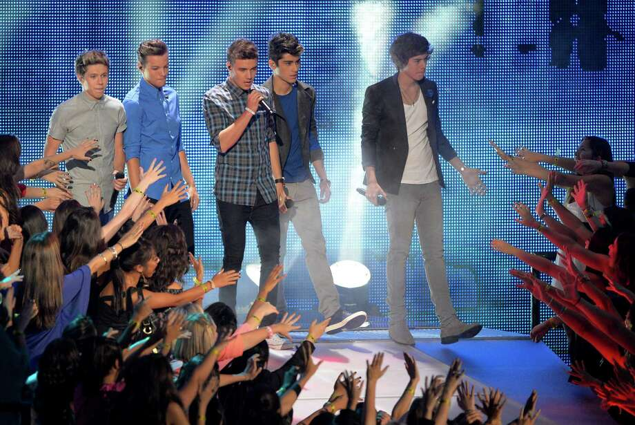 """Fame has really gotten to One Direction – the boy band's five members can no longer relate to the regular people they used to be friends with in Britain. On the U.K. talk show """"Loose Women,"""" Harry Styles said, """"I think a lot of people kind of feel like whatever they say isn't as exciting so they just don't know what to say to us. A lot of the time (with) friends that you've had for quite a while, it just becomes awkward."""" We're sure your old friends are very sorry for making you feel awkward.  Photo: Mark J. Terrill, INVL / Invision"""