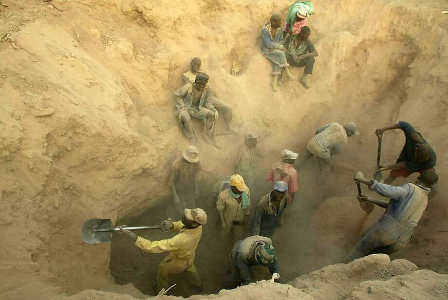 Miners dig for diamonds in Marange, Zimbabwe. Funds from the vast sales of diamonds have not shown up in the country's treasury, a group says. Photo: Tsvangirayi Mukwazhi, Associated Press