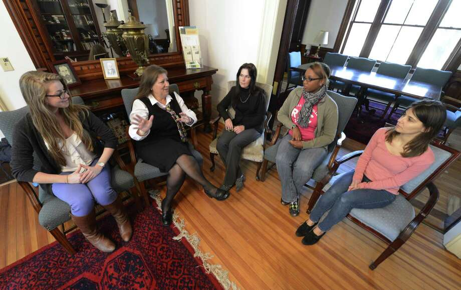 Lori Quigley, second from left, dean of the Esteves School of Education, speaks with student Monique Merchant, left; Elizabethe Kelley, associate professor and faculty adviser, center; Thearse McCalmon, president of the Native American Student Organization, second from right; and student Diana Vuksa at an informal meeting of the Native American Student Organization at Russell Sage College in Troy, N.Y., on Nov. 12, 2012.  (Skip Dickstein/Times Union) Photo: SKIP DICKSTEIN / 00020050A