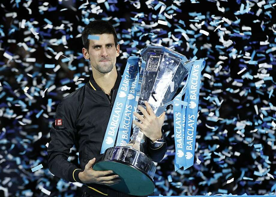 Novak Djokovic owns the championship trophy of the season finale for the second time. Photo: Sang Tan, Associated Press