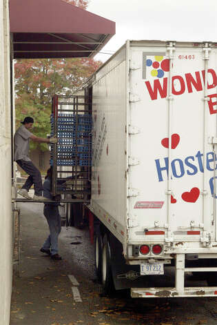 In this Oct. 6, 2004 photo, workers unload baking racks from a truck at the Hostess Bakery at 434 Dexter Avenue N. in Seattle. Interstate Bakeries, the parent company when the photo was taken, had filed for bankruptcy. Photo: Phil H. Webber/seattlepi.com File