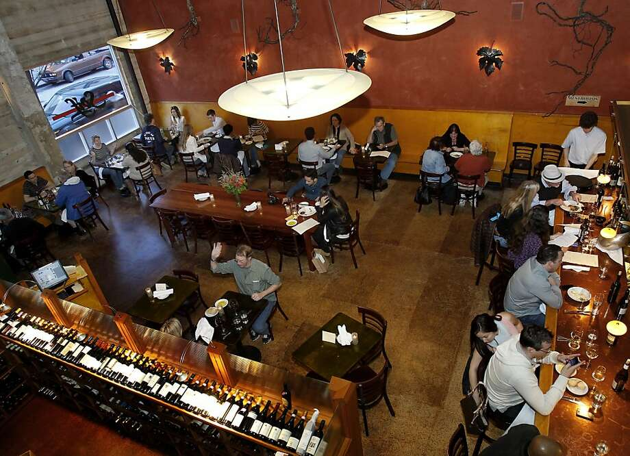 Clockwise from top: Soif's dining room, seen from above, offers sophisticated food and wine pairings. Its wine bar is in the back, adjacent to the dining area. The downtown venue features weekly and monthly events, including tastings at the wine shop next door. Photo: Brant Ward, The Chronicle