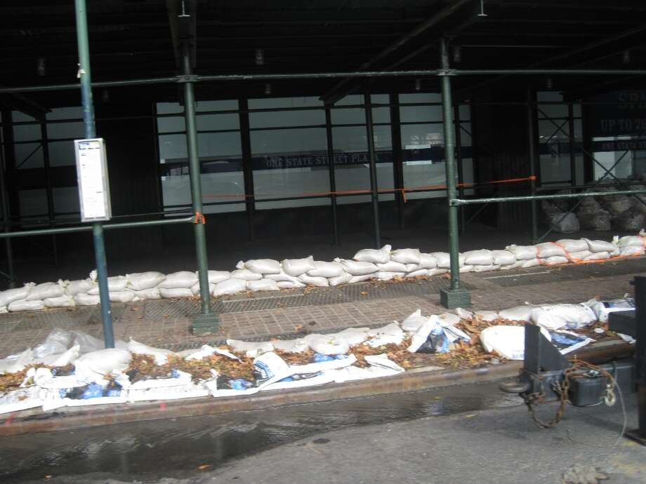 Sand bags line the street in downtown New York.  (Jana Kasperkevic / Houston Chronicle)
