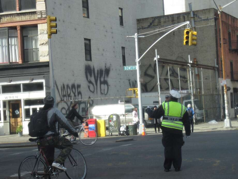 With the lack power, the traffic at many intersection in both Manhattan and Brooklyn was directed by the New York Police Department.  (Jana Kasperkevic / Houston Chronicle)
