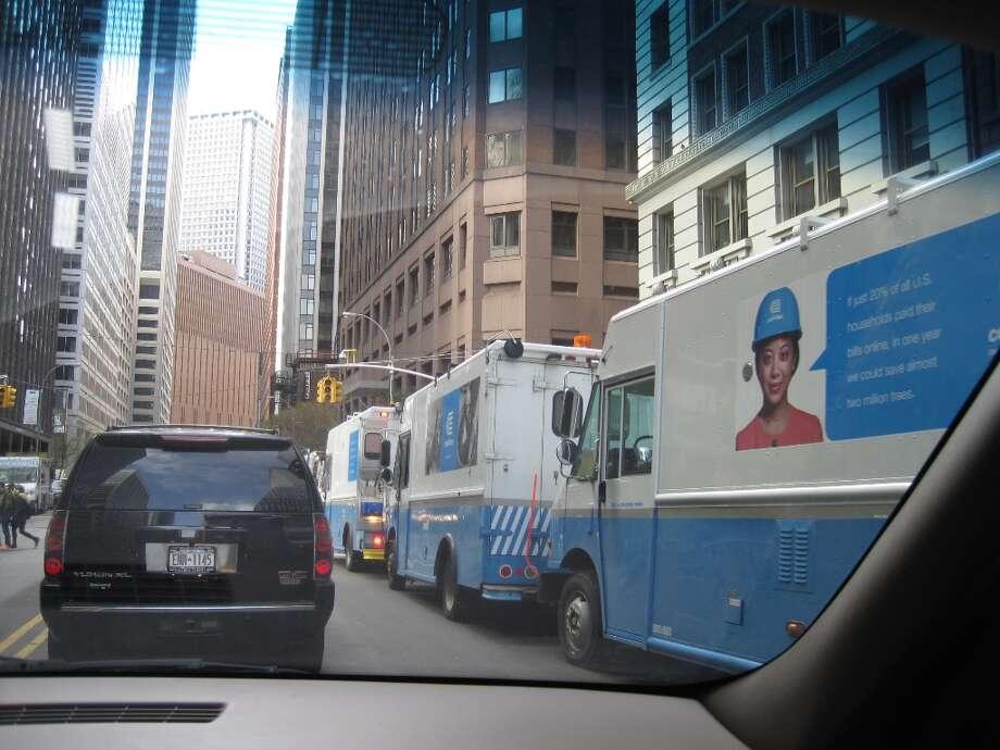 Con Ed trucks lined the streets in downtown Manhattan, just blocks south of South Street Sea Port on Nov. 1.   (Jana Kasperkevic / Houston Chronicle)