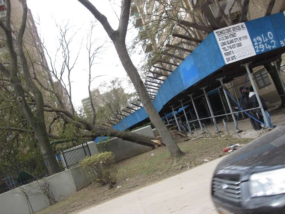 Fallen trees were seen throughout Brooklyn after Superstorm Sandy had hit the area.  (Jana Kasperkevic / Houston Chronicle)